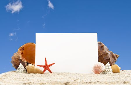 medium group of object:   Cockleshell with a pearl necklace on sand and a piece of a paper for a note Stock Photo