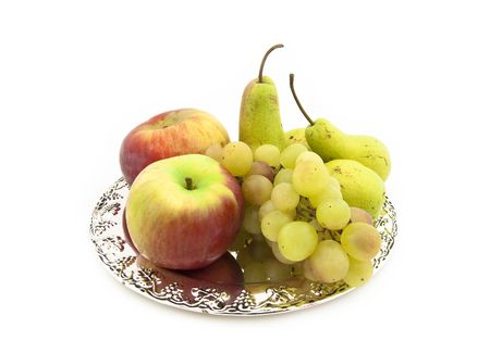 Grapes, apples and pears on a silver dish photo