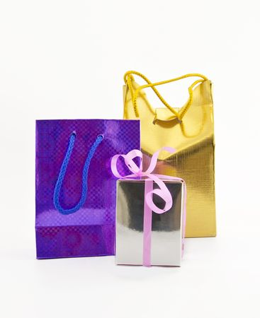 Coloured gift packages on a white background photo