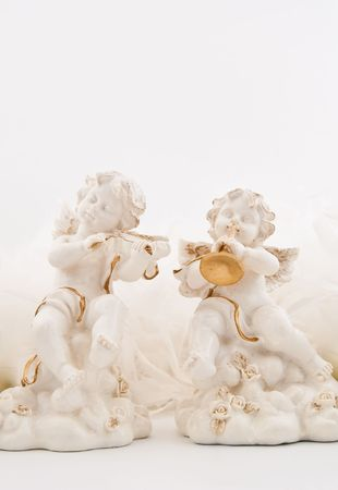 Figurines in the form of the angels playing musical instruments photo