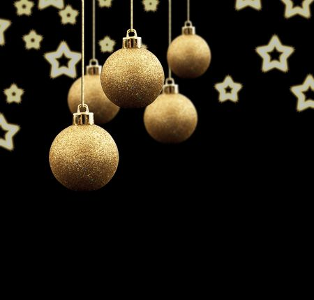 group of christmas baubles:  Gold Christmas balls on a black background