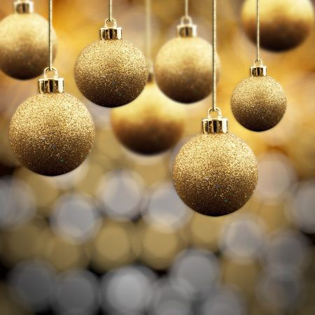group of christmas baubles: Gold Christmas balls on a multi coloured sparkling background