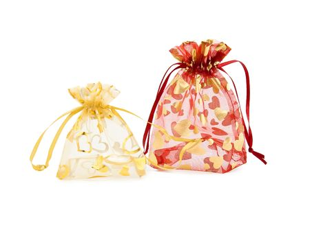 Elegant bags for gifts on a white background photo