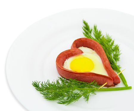 Fried sausage in the form of heart on a white background photo
