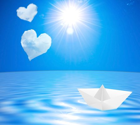 Sea landscape with clouds in the form of hearts and a paper boat on water Stock Photo - 6446534