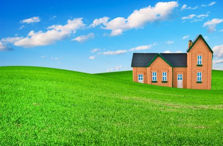 The house on a grass under the dark blue sky Stock Photo - 6606849