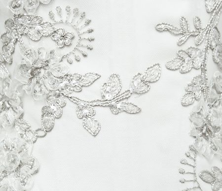 The beautiful embroidered ornament on a wedding dress photo