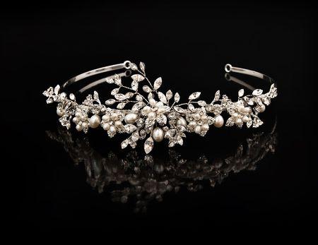 tiara: Diamond diadem on a black background with reflexion