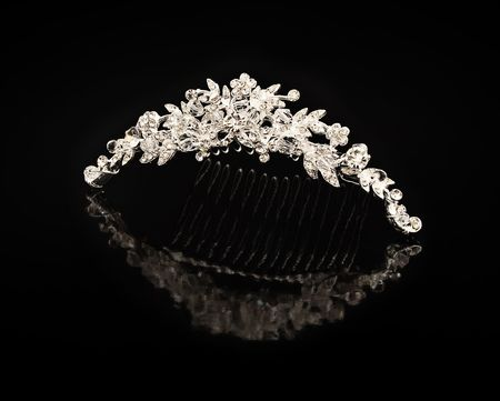 Diamond comb for hair on a black background with reflexion Stock Photo - 6675972