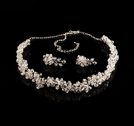 Diamond necklace and earrings on a black background  photo