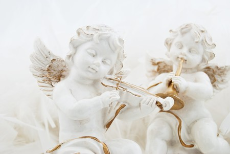 Figurines in the form of the angel playing musical instruments photo