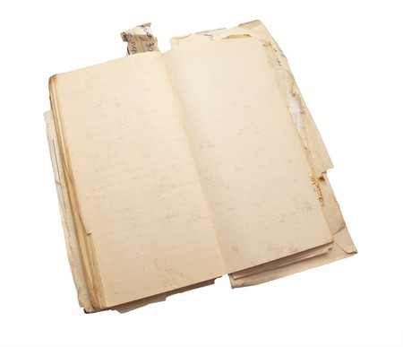 Ancient notebook for notes with the turned yellow pages isolated on a white background photo