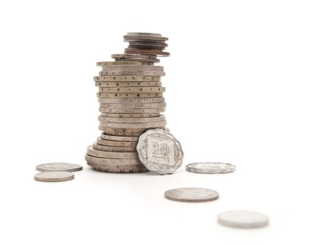 are combined: Various steel coins combined by a column on a white background Stock Photo