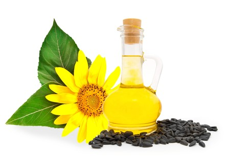 sunflowerseed: Small bottle with sunflower-seed oil and sunflower seeds