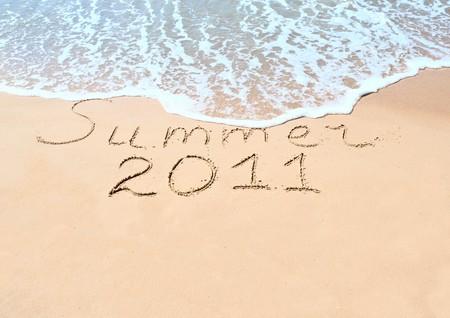 Inscription on wet sand  photo