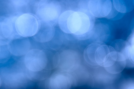 Abstract dark blue background in the form of bright various bokeh photo
