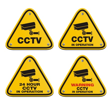 cctv: CCTV in operation - yellow sign