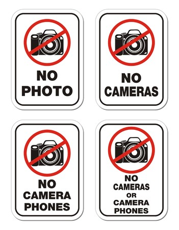 cell phones not allowed: no camera phones signs