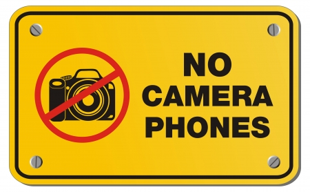 cell phones not allowed: no camera phones yellow sign - rectangle sign