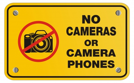 cell phones not allowed: no cameras or camera phones yellow sign - rectangle sign