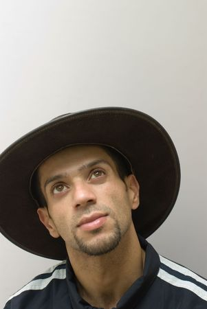 Young Asian man wearing cowboy hat photo