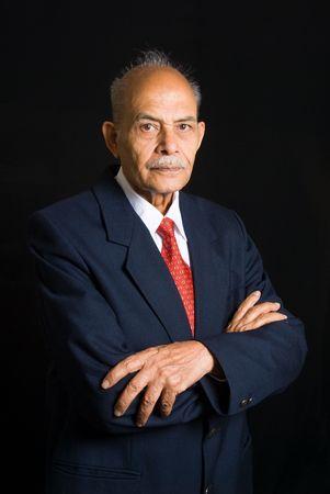A portrait of a senior Asian Indian businessman