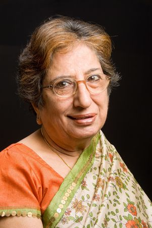 A senior East Indian woman wearing a sari Stock Photo