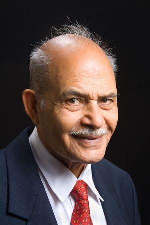 A portrait of a senior Indian businessman