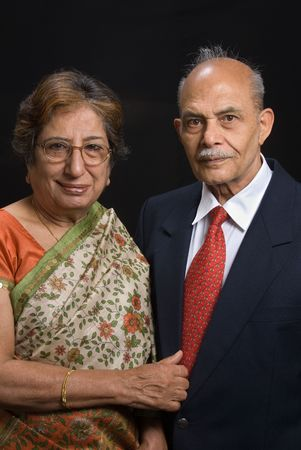 A portrait of an elegant East Indian couple photo