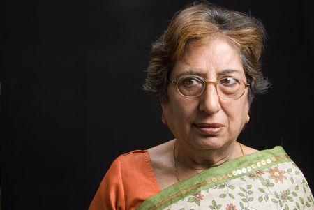 Portrait of a senior Indian woman wearing a sari