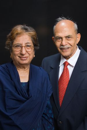 A portrait of senior Asian  East Indian couple smiling into the camera photo