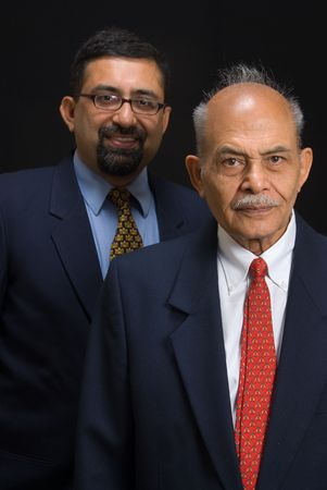 indian happy family: A portrait of two Asian business executives