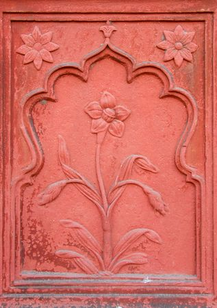 red  stone: Intricate stone carving of a flower