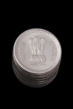 Stack of Indian coins isolated on black background photo