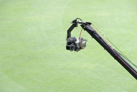 jib: TV broadcast camera on jib or crane in a stadium Stock Photo
