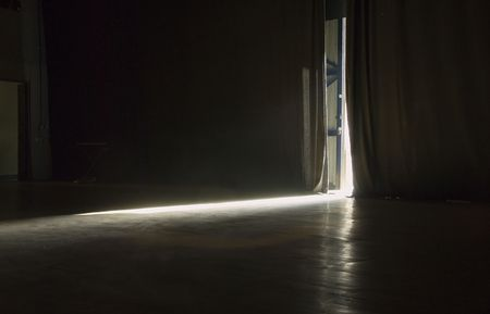 backstage: Light streaming into a stage Stock Photo
