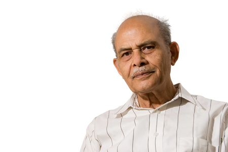 A portrait of a Senior Indian - isolated in white