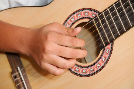 A close up of a guitar player Stock Photo