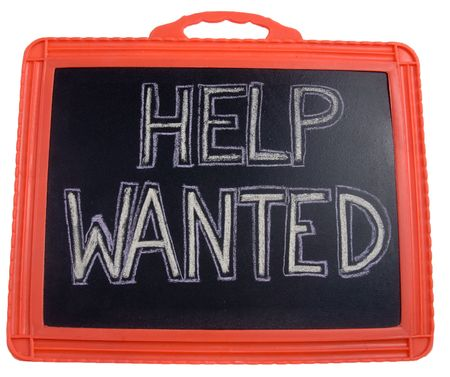 A help wanted sign on a slate board