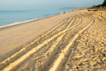 4x4 tracks on the beach in Candolim, Goa in India photo