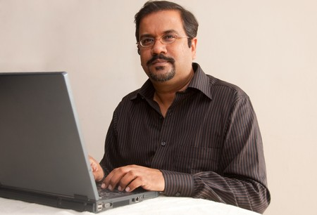 An Indian man on his laptop