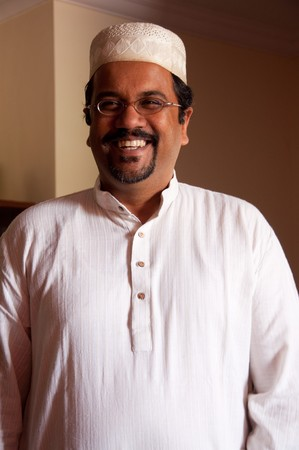 A modern Muslim man wearing traditional dress Stock Photo