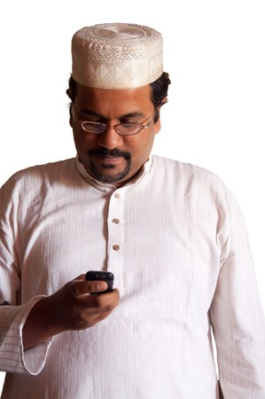 Muslim man checks his mobile phone - isolated on white photo