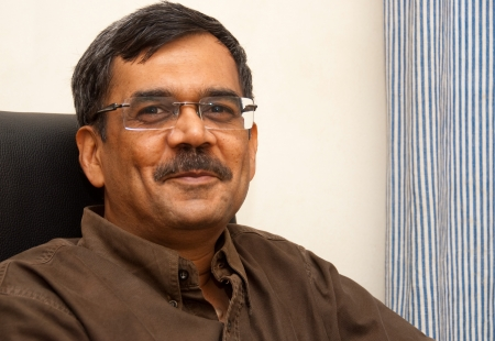 A portrait of a smiling Indian man Stock Photo