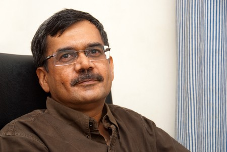 A portrait of an Indian professional
