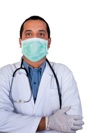 An isolated image of an Asian  Indian doctor wearing a surgical mask Stock Photo