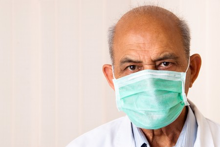 An Indian  Asian doctor or dentist wearing a mask photo