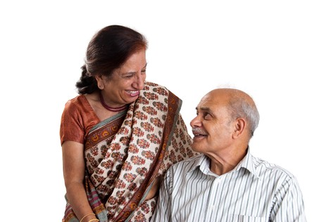 A senior Asian couple having a laugh together - isolated in white