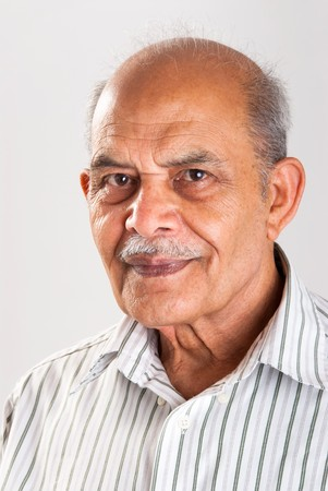 A portrait of a senior Indian man photo