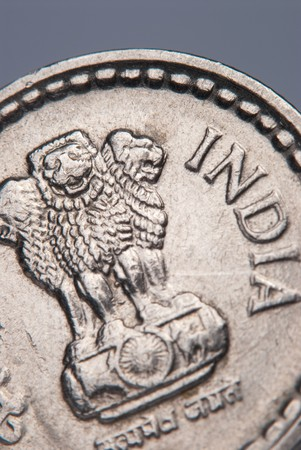 A closeup of a Indian coin - shallow DOF photo